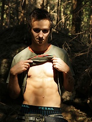 Twink Jake Palace jerking off in the woods. - Gay porn pics at GayStick.com