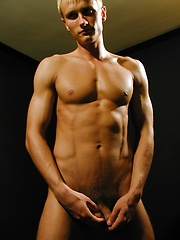 Ripped stud Michael Davids plays with this uncut dick. - Gay porn pics at GayStick.com