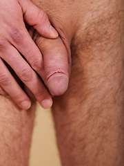 Marshall Kone busts a big nut over his hairy bellybutton. - Gay porn pics at GayStick.com