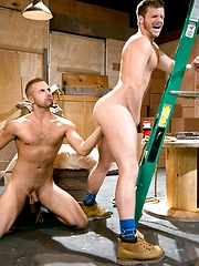 Brian Bonds steadies himself against a stepladder as crew-cut Zack Taylor massages his hole with a gloved fist - Gay porn pics at GayStick.com