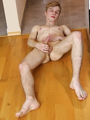 Skinny dude Julian Caro strokes his beautiful cock.